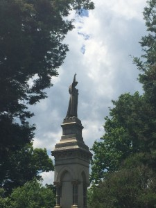 An angel over Daisy Wiliams' final resting places raises her arm to the sky.