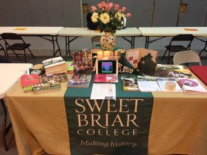 Our table featured fliers on programs, brochures with smiling faces and (our secret weapon it turned out) FLOWERS.